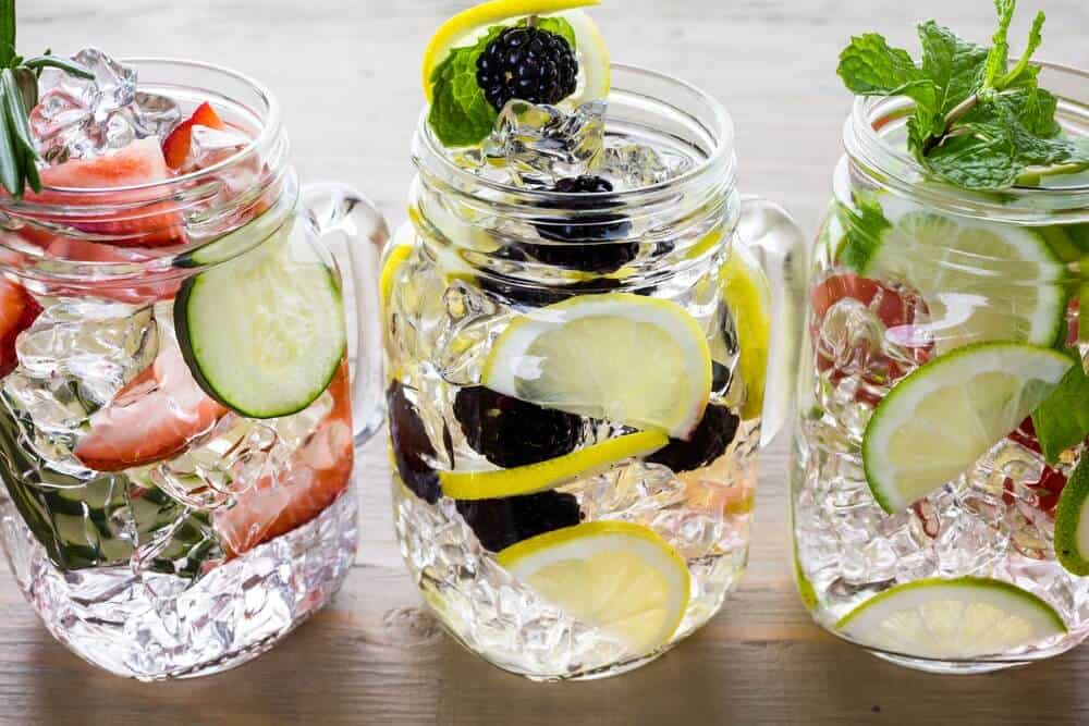Jars with fruit infused water perfect to drink on keto diet